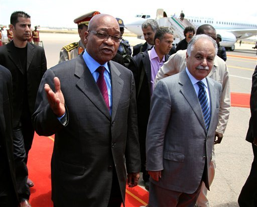 In this photo released by China's Xinhua News Agency, Libya's Prime Minister Baghdadi Mahmudi, front right, welcomes South African President Jacob Zuma, front left, upon his arrival in Tripoli, Libya, Monday, May 30, 2011.