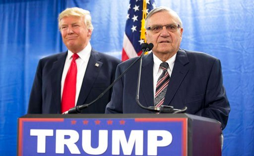 FILE - In this Jan. 26, 2016 file photo, then-Republican presidential candidate Donald Trump was joined by Joe Arpaio.  (AP Photo/Mary Altaffer, File)