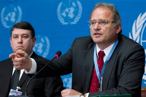 Christof Heyns, right, Special Rapporteur on extrajudicial, summary or arbitrary executions, sits next to Jeff S. Spivack, left, Forensic Video Analyst, while he presents his findings in relation to the authenticity of video footage.