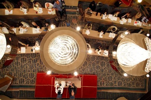 The ceiling reflects the press conference held by General Manager of New York's Metropolitan Opera Peter Gelb, bottom right, in Tokyo. (AP Photo/Shizuo Kambayashi)