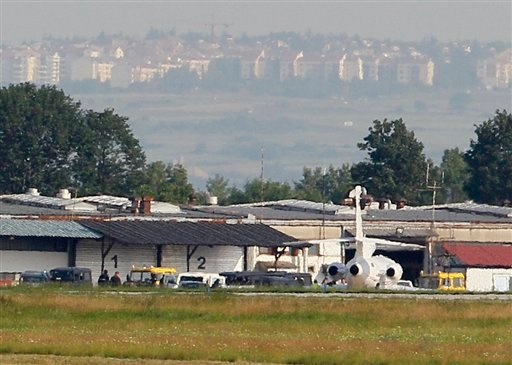 The police motorcade that escorted war crimes suspect Ratko Mladic parks near a plane at a Belgrade International Airport, Serbia. (AP Photo/Darko VojinovIc)