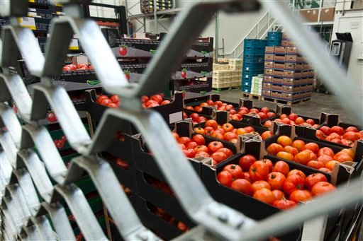 Boxes containing tomatoes stand behind a fence at the closed shop of a distributor at the central fruit and vegetable market in Berlin on Tuesday, afternoon, May 31, 2011.