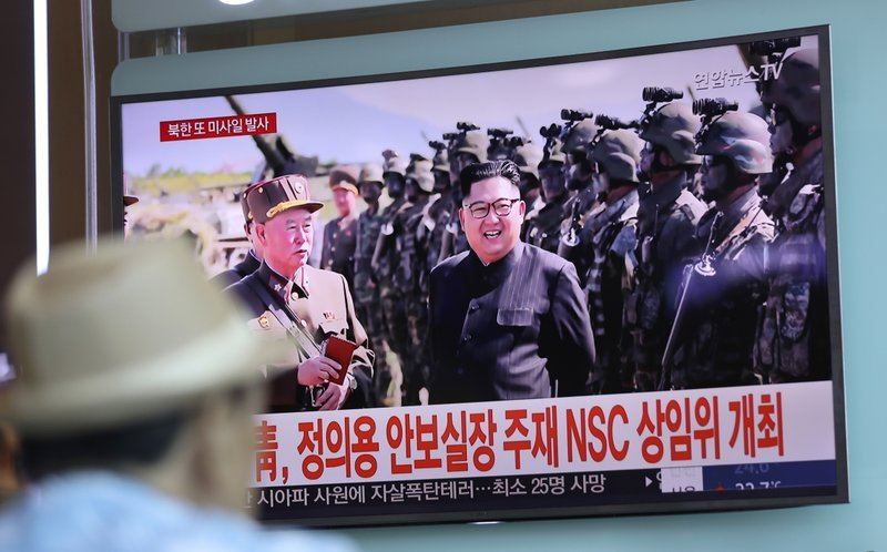 In this Saturday, Aug. 26, 2017, file photo, a man watches a screen showing an image of North Korean leader Kim Jong Un, at the Seoul Train Station in Seoul, South Korea.