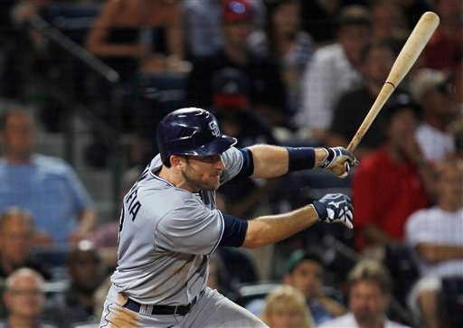 San Diego Padres right fielder Chris Denorfia (13) puts his team ahead with an RBI single in the seventh inning of a baseball game against the Atlanta Braves in Atlanta Tuesday, May 31, 2011.