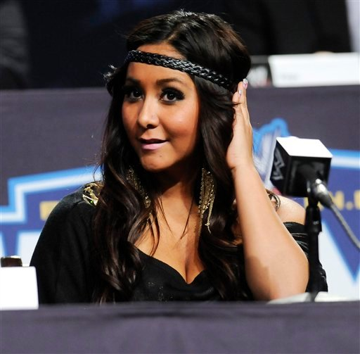 "FILE - In this March 30, 2011 file photo, reality television star Nicole ""Snooki"" Polizzi participates in a Wrestlemania XXVII news conference at the Hard Rock Cafe in New York. Polizzi and a fellow ""Jersey Shore"" cast member have been involved in a minor"