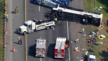 Rescue personnel work at the scene of a bus accident that killed four and injured several others in Bowling Green, Va., Tuesday, May 31, 2011. (AP Photo/Steve Helber)