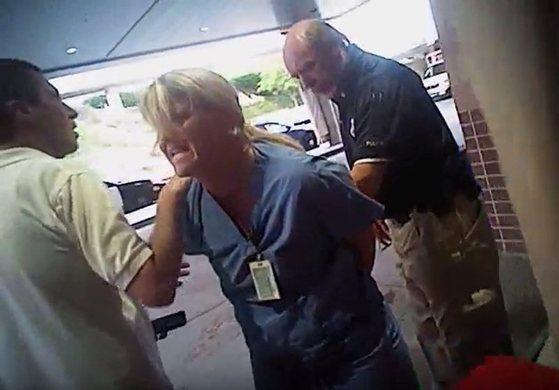 In this July 26, 2017, frame grab from video taken from a police body camera and provided by attorney Karra Porter, nurse Alex Wubbels is arrested by a Salt Lake City police officer at University Hospital in Salt Lake City.