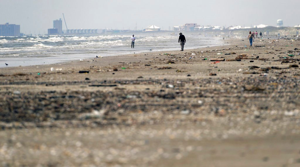 A beach normally filled with people on a holiday weekend is peppered with trash and debris in the wake of Hurricane Harvey, Sunday, Sept. 3, 2017, in Port Aransas, Texas. (AP Photo/Eric Gay)