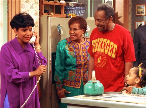 In this 1992 file photo originally released by NBC, Phylicia Rashad, portraying Clair Huxtable, left, talks on the telephone while Clarice Taylor, portraying Anna Huxtable, center, and Bill Cosby, portraying Dr. Cliff Huxtable.