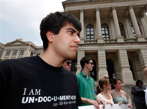 Immigration activist Mohammad Abdollahi, left, stands outside the Capitol building in Atlanta during a press conference where it was announced that several civil liberty groups have file lawsuits challenging Georgia's new immigration law.