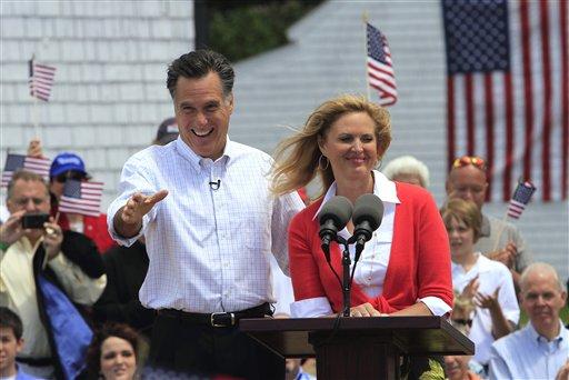 Former Massachusetts Gov. Mitt Romney of Massachusetts, accompanied by his wife Ann, arrives to announce his 2012 candidacy for president, Thursday, June 2, 2011, in Stratham, N.H.