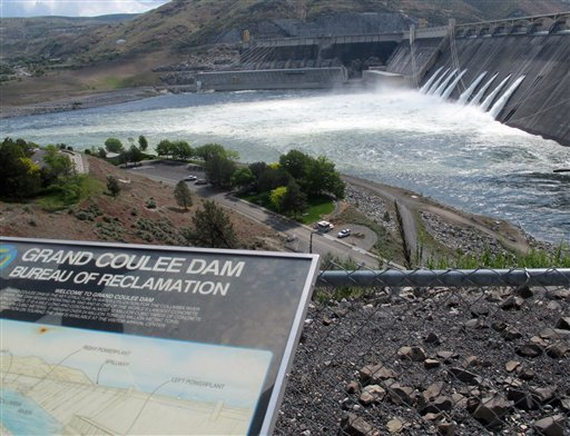 In this June 1, 2011 photo, water is seen being released through the outlet tubes at Grand Coulee Dam, Wash.