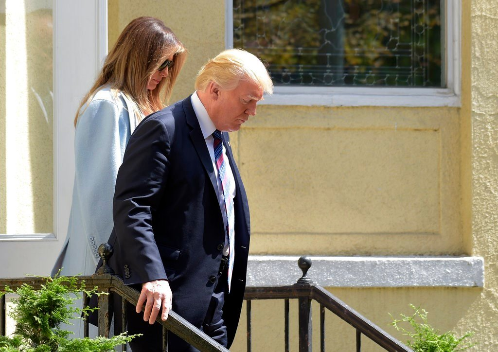 President Donald Trump and first lady Melania Trump leave after attending services at St. John's Church in Washington.
