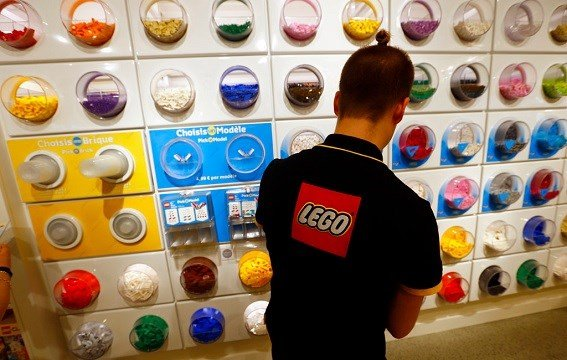 April 5, 2016 file photo, an employee sorts Legos in the the new LEGO flagship store.