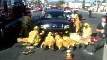 Firefighters free boy pinned under SUV in El Cajon, Friday, June 3, 2011.