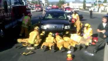 Firefighters free boy pinned under SUV in El Cajon, Friday, June 3, 2011.