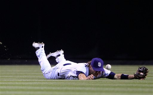 San Diego Padres center fielder Blake Tekotte can not make the catch on a base hit by Houston Astros' Carlos Lee in the sixth inning of a baseball game, Thursday, June 2, 2011, in San Diego. (AP Photo/Lenny Ignelzi)