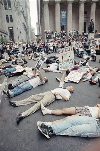In this Thursday, Sept. 14, 1989 file picture, protestors lie on the street in front of the New York Stock Exchange in a demonstration against the high cost of the AIDS treatment drug AZT. The protest was organized by ACT UP, a gay rights activist group.