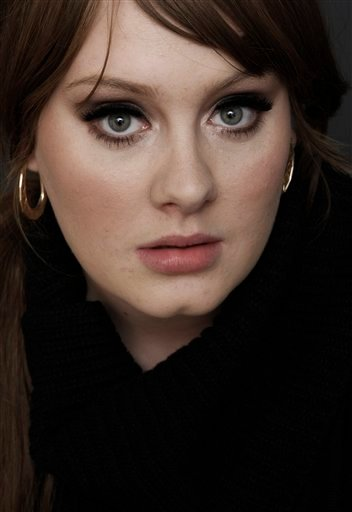 "FILE - In this Nov. 19, 2008 file photo, British singer Adele poses for a portrait in Los Angeles. Adele's song ""Rolling In the Deep,""is iTunes' top selling single, and her album ""21"" is the second top selling album of the week ending May 30, 2011."