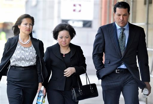 Vivian Van Le, mother of Annie Le, center walks with Joseph Tacopina, attorney for the Le family, right, and an unidentified woman, left, outside Superior Court in New Haven, Conn., Friday, June 3, 2011.