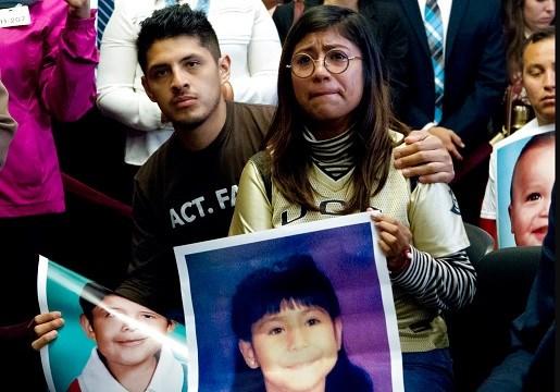 Dreamers Karen Caudillo, 21, of Florida is comforted by Jairo Reyes, 25, of Rogers, Arkansas as Sen.