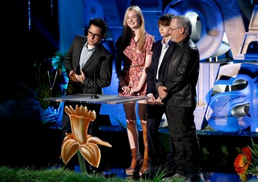 From left, JJ Abrams, Elle Fanning, Joel Courtney and Steven Spielberg introduce an exclusive clip at the MTV Movie Awards on Sunday, June 5, 2011, in Los Angeles. (AP Photo/Matt Sayles)