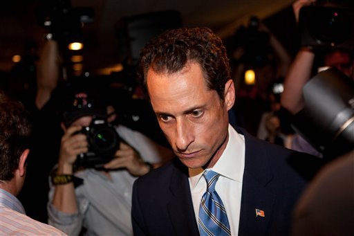 "U.S. Rep. Anthony Weiner, D-N.Y., leaves a news conference in New York Monday, June 6, 2011, where he confessed that he tweeted a bulging-underpants photo of himself to a young woman and admitted to ""inappropriate"" exchanges with six women."