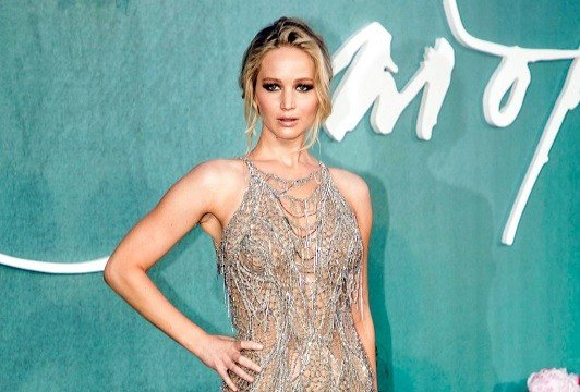 Jennifer Lawrence poses for photographers upon arrival at the premiere of the film Mother'', in London.