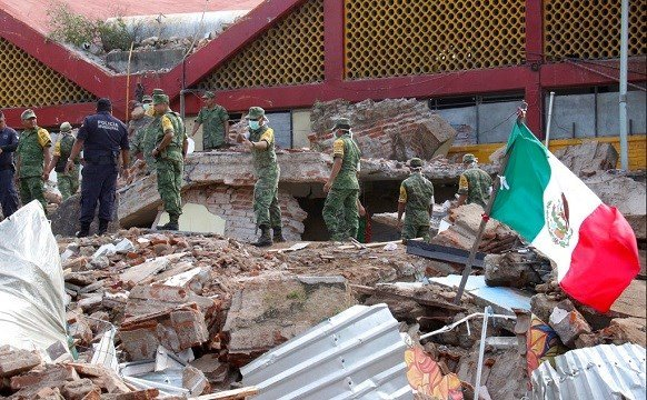 Soldiers remove debris from a partly collapsed municipal building felled by a massive earthquake in Juchitan, Oaxaca state, Mexico.