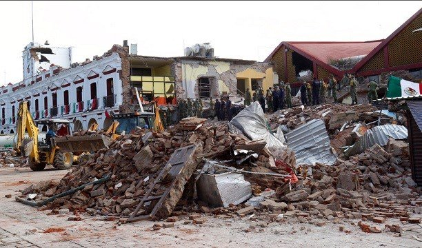 Soldiers remove debris from a partly collapsed municipal building after an earthquake in Juchitan, Oaxaca state, Mexico.
