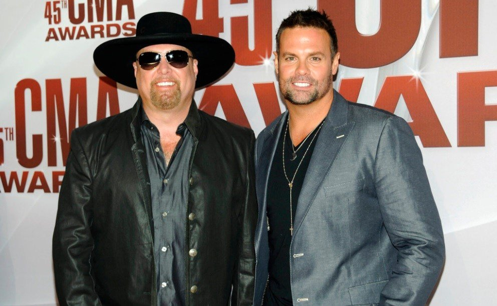Eddie Montgomery, left, and Troy Gentry of Montgomery Gentry arrive at the 45th Annual CMA Awards in Nashville, Tenn.