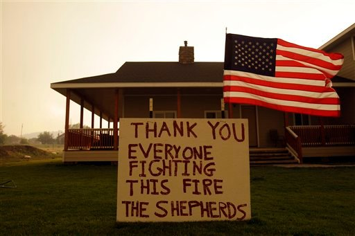 A sign outside of a home thanks firefighters for their efforts as the Wallow fire approaches in Eagar, Ariz., Tuesday, June 7, 2011. (AP Photo/Marcio Jose Sanchez)