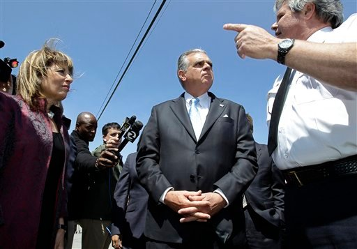 Transportation Secretary Ray LaHood, center, and Rep. Jackie Speier (D-San Mateo), left, listens to San Bruno fire chief Dennis Haag, right, during a tour of the site of the pipeline explosion in San Bruno, Calif. May 19, 2011. (AP Photo/Paul Sakuma)