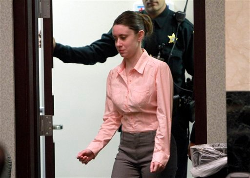 Casey Anthony enters the courtroom for the start of the 13th day of her murder trial at the Orange County Courthouse, Wednesday, June 8, 2011, in Orlando, Fla.
