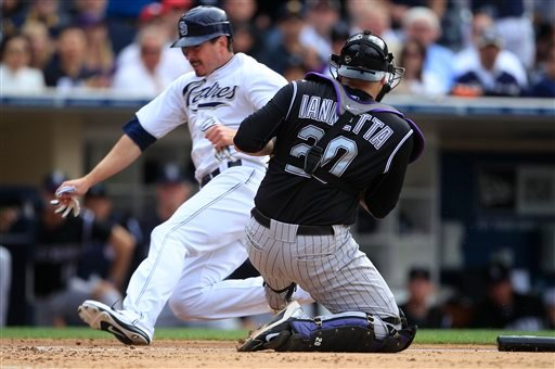 Colorado Rockies catcher Chris Iannetta juggles the throw as San Diego Padres' Brad Hawpe slides in to score during the sixth inning of a baseball game, Wednesday, June 8, 2011, in San Diego. (AP Photo/Lenny Ignelzi)