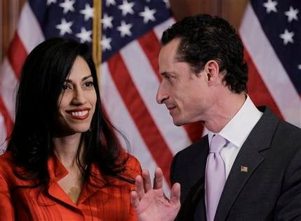 In this Jan. 5, 2011, file photo, Rep. Anthony Weiner, D-N.Y., and his wife, Huma Abedin, aide to Secretary of State Hillary Rodham Clinton, are pictured. (AP Photo/Charles Dharapak, File)