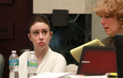 Casey Anthony listens to her attorney Dorothy Clay Sims before the start of her murder trial at the Orange County Courthouse, Thursday, June 9, 2011 in Orlando, Fla. (AP Photo/Joe Burbank, Pool)