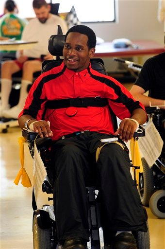 In this May 24, 2011 file photo, Georgia baseball player Johnathan Taylor is released from the Shepherd Center in Atlanta.