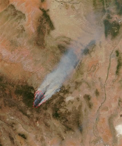 This image provided by NASA shows the Wallow fire in eastern Arizona taken Wednesday June 8, 2011 from the MODIS instrument on board the Aqua satellite.