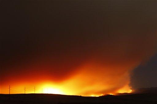 The Wallow fire burns towards Eagar, Ariz, north of Greer, Ariz,, Wednesday night June 8, 2011.
