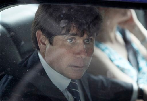 Former Illinois Gov. Rod Blagojevich looks out the window of his car after departing the Federal Court building on the first day of closing arguments in his corruption trial Wednesday, June 8, 2011 in Chicago.