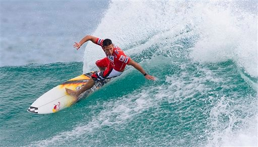 FILE - This Feb. 27, 2008, photo provided by Covered Images, shows former Association of Surfing Professionals world champion Andy Irons competing in the Quiksilver Pro at Snapper Rocks on the Gold Coast in Queensland, Australia.