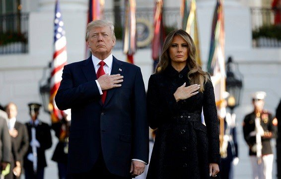 President Donald Trump and first lady Melania Trump stand for a moment of silence to mark the anniversary of the Sept. 11 terrorist attacks