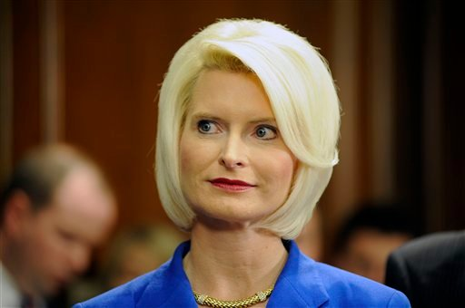 FILE - In this March 3, 2011 file photo, Callista Gingrich listens as her husband former House Speaker Newt Gingrich speaks at a news conference in Atlanta.
