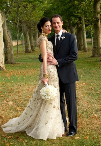 In this July 10, 2010, file photo provided by Marie Ternes, Rep. Anthony Weiner, D-N.Y., poses with his wife Huma Abedin, aide to Secretary of State Hillary Rodham Clinton, for a formal wedding portrait at the Oheka Castle in Huntington, N.Y.