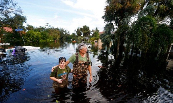 Kelly McClenthen returns to see the flood damage to her home in the aftermath of Hurricane Irma in Bonita Springs, Fla., Monday, Sept. 11, 2017.