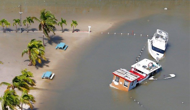 Boats are partially submerged in the wake of Hurricane Irma, Monday, Sept. 11, 2017, in Key Largo, Fla.