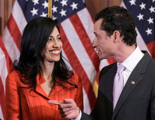 Rep. Anthony Weiner, D-N.Y., and his wife, Huma Abedin, an aide to Secretary of State Hillary Rodham Clinton, are pictured after a ceremonial swearing in of the 112th Congress on Capitol Hill in Washington on Jan. 5, 2011. (AP Photo/Charles Dharapak)