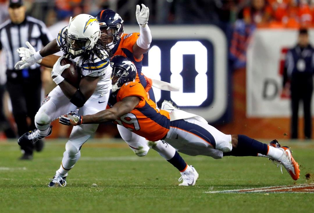 Los Angeles Chargers running back Melvin Gordon (28) is hit by Denver Broncos cornerback Bradley Roby (29) during the second half of an NFL football game, Monday, Sept. 11, 2017, in Denver. (AP Photo/David Zalubowski)