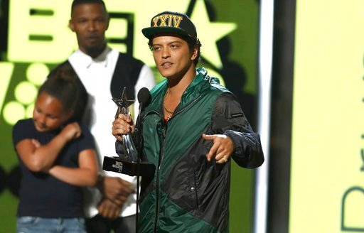 Bruno Mars accepts the award for best male R&B/pop artist at the BET Awards at the Microsoft Theater on Sunday, June 25, 2017, in Los Angeles.